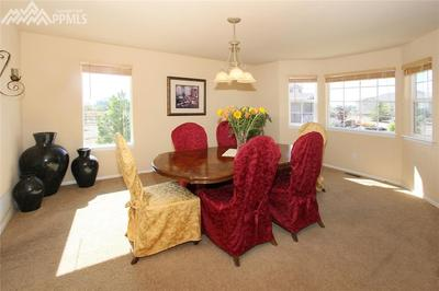 Sunny formal dining room with big bay window