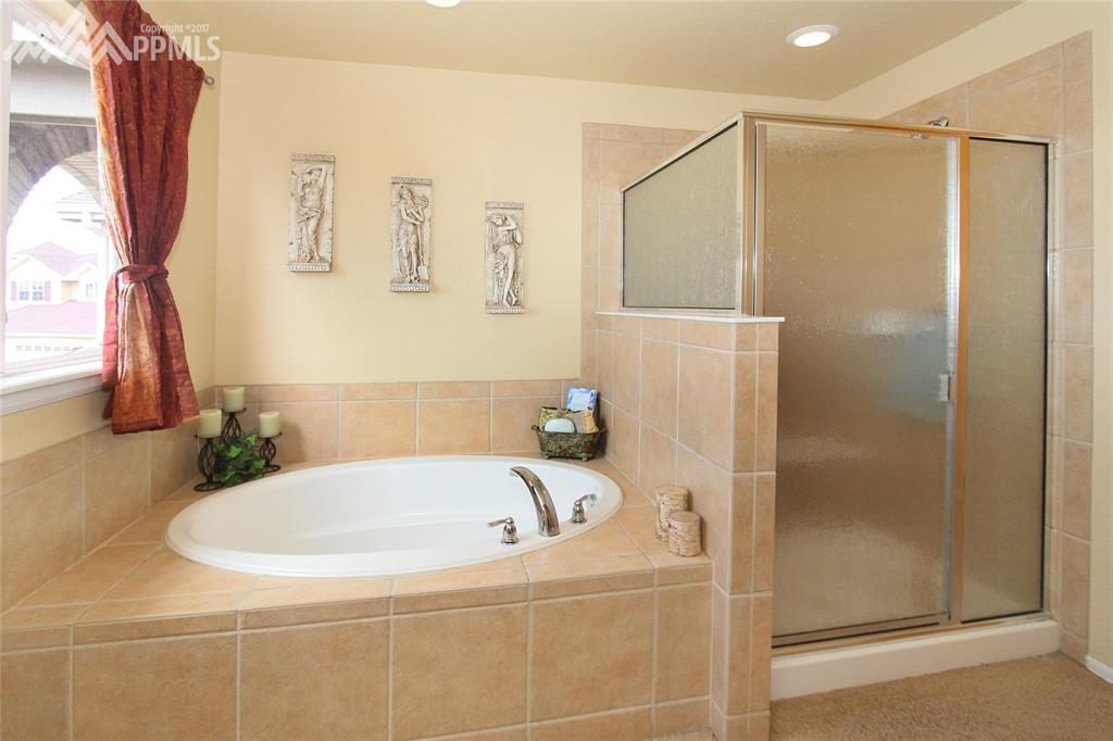 Oval soaking tub & separate shower in master bath