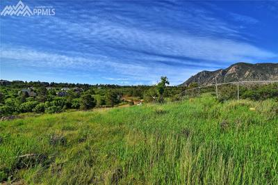 View to the south.  Fencing is property line.  Butts up to Broadmoor Resort prop