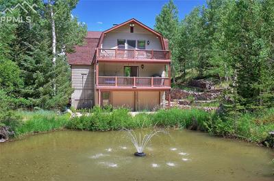 Welcome Home! Front View of the home and Trout Pond