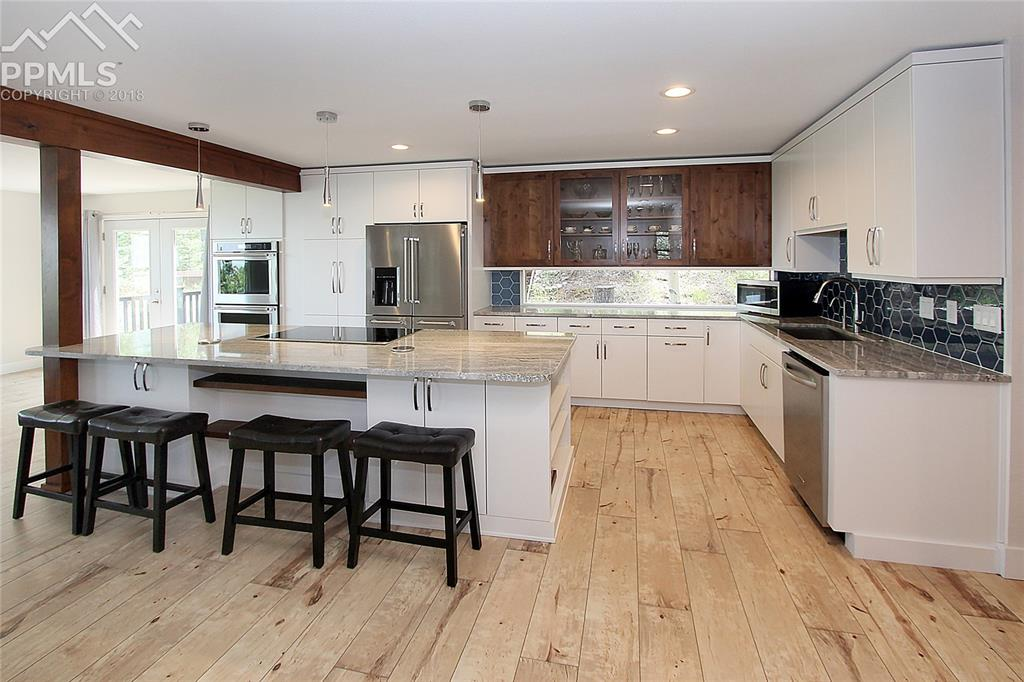 View #4 of the Kitchen-- Stainless Steel Appliances, Double Oven & Granite Count