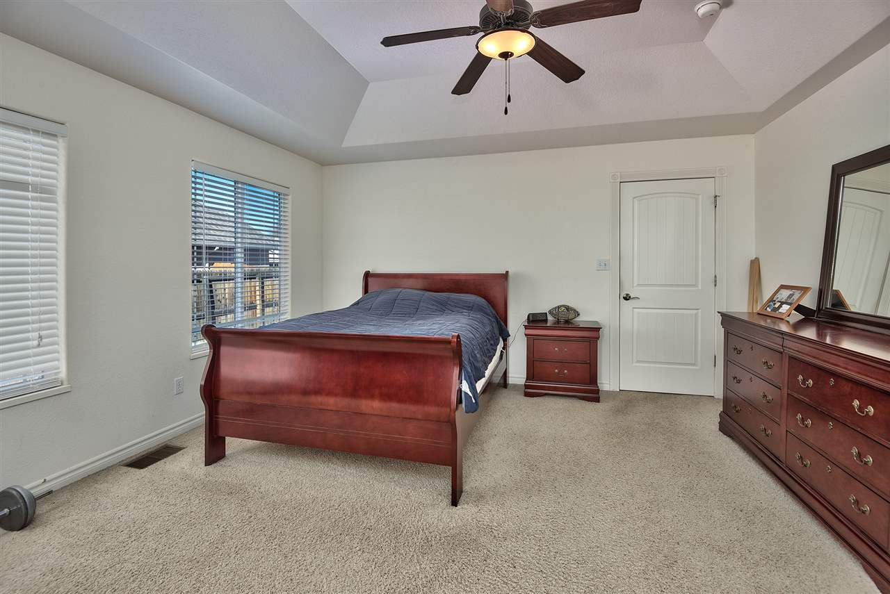The master suite offers dual walk-in closets and a trayed ceiling!