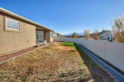 Enjoy your backyard and covered patio in this fully-privacy fenced rear yard!