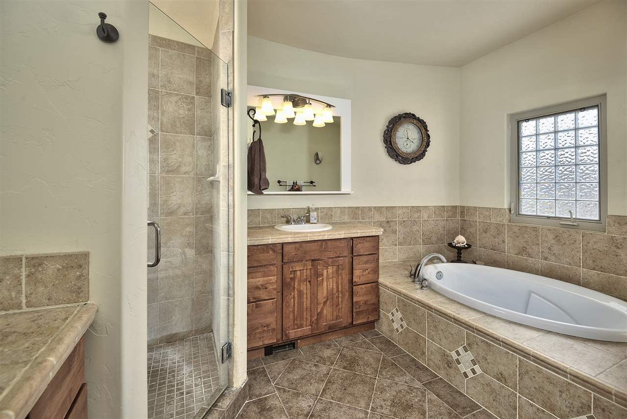 This gorgeous Redlands home boasts the coveted 5-piece master suite, w/custom ti