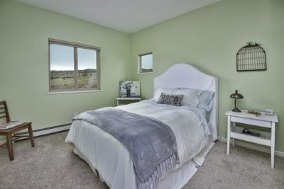 This Redlands home offers lots of space inside & out, with 2,676 square feet sit