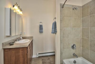 A nicely-finished full guest bathroom services the two upper-level secondary bed