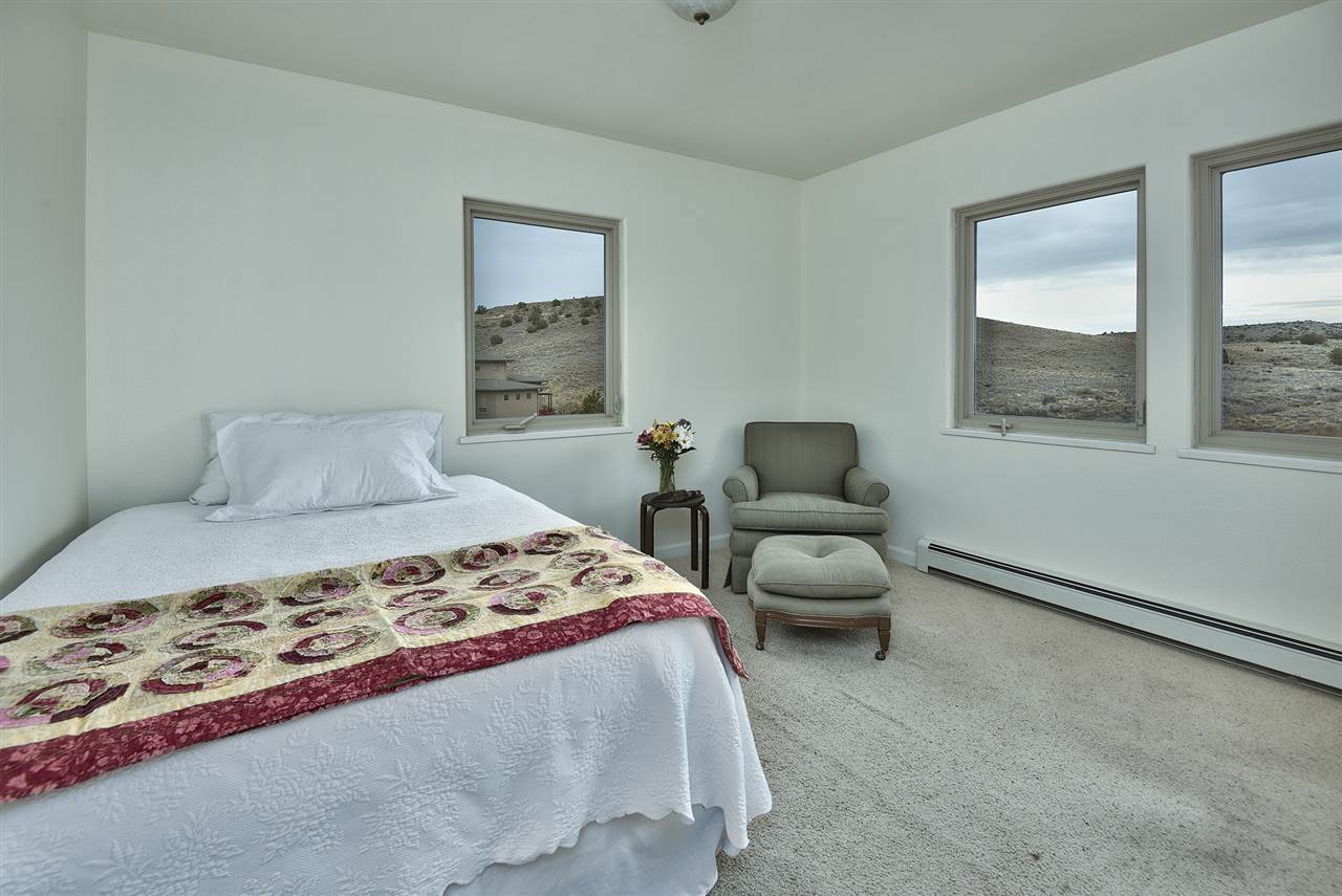 In addition to three bedrooms in the main home, there are two bonus rooms above