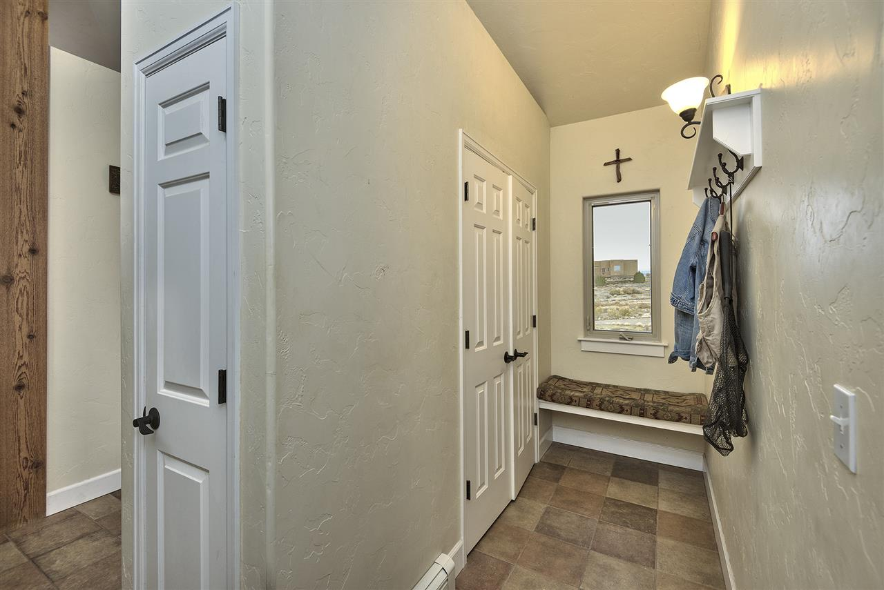 The mudroom offers a comfy, padded windowseat - with a view!