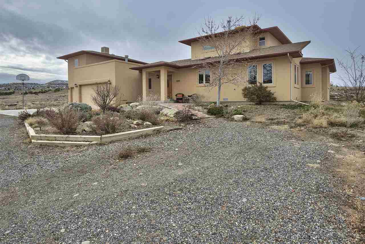 Easy-care xeriscaping surrounds the home, w/the bulk of the home's 2+ acres in n