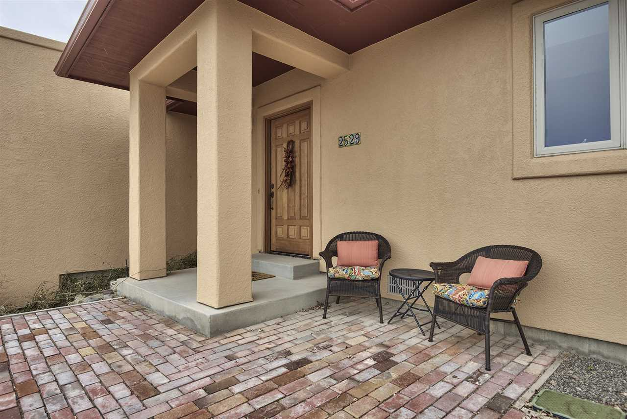 This east-facing front patio offers views of the rising sun while enjoying your