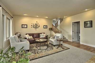 The warm and inviting living room is open to the kitchen, making for great enter