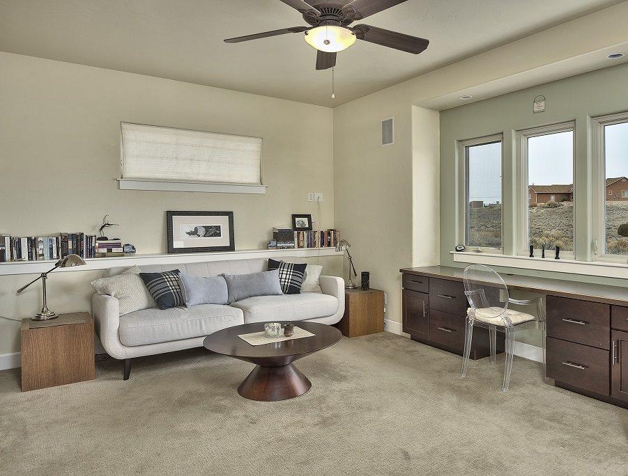 This custom Redlands home offers a separate family room with a trio of windows e