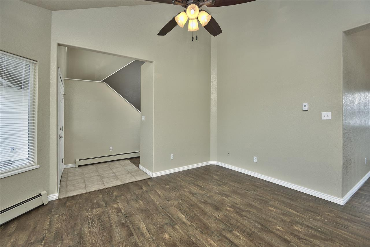 Tile Entry Gives Way to Wood Laminate Living Room!