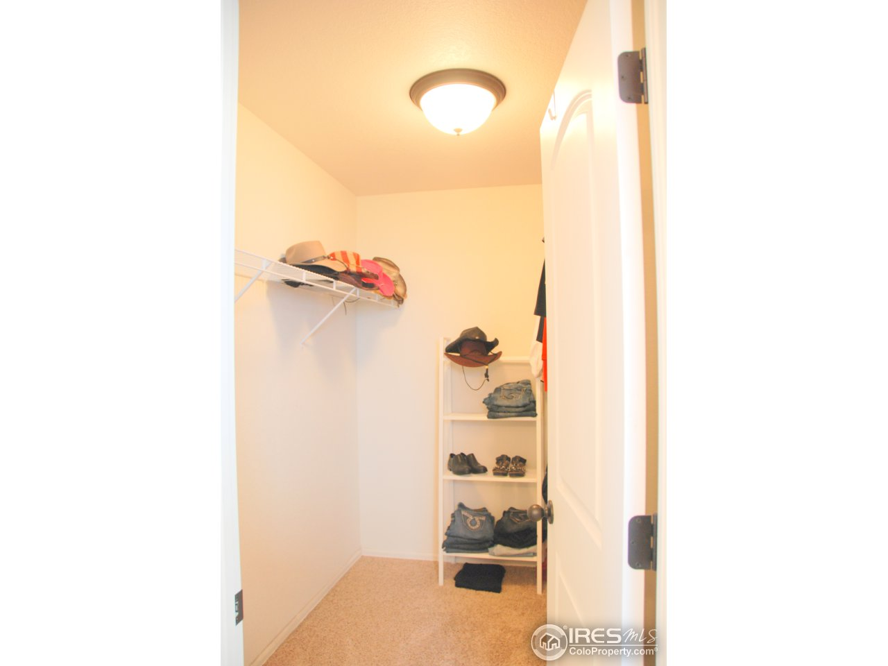 Master walk-in closet, more room behind door