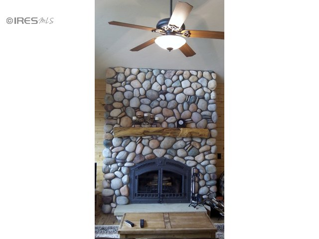 Rock fireplace with wood burning  insert