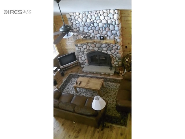 floor to ceiling rock fireplace