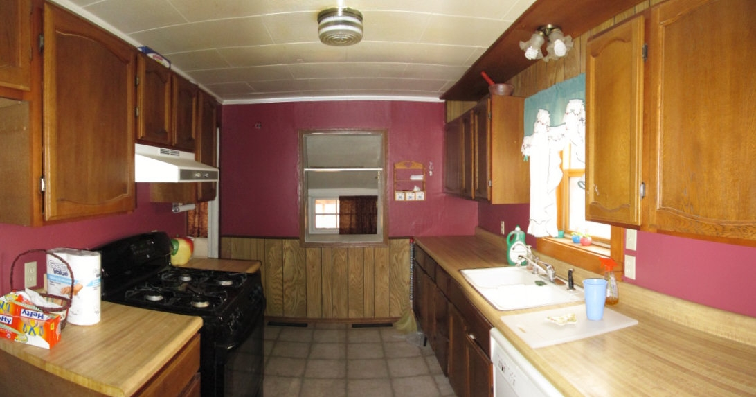 Galley style kitchen with appliances included