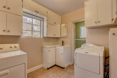 Laundry room with 1/2 bath -- washer & dryer are included.