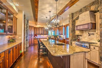 Large Gourmet Kitchen with Custom Cabinetry, Granite Countertops, Hardwood Floor