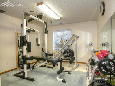 Third bedroom used as a gym.