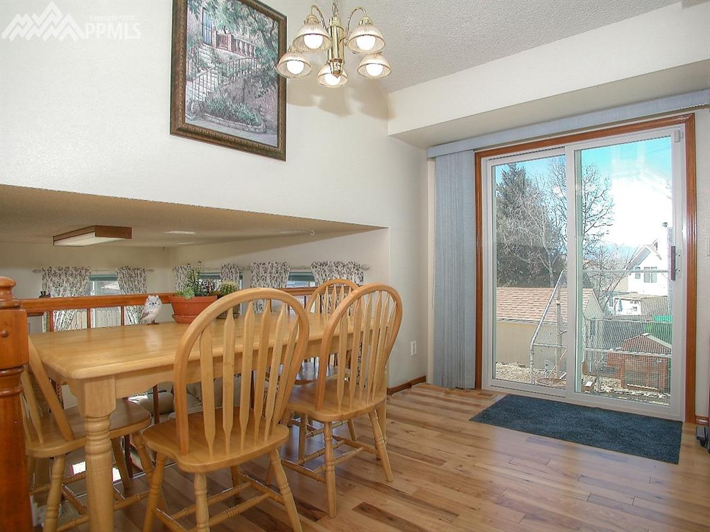 Casual dining overlooks family room.