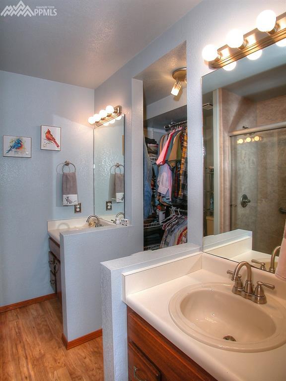 Master separate vanities and walk-in closet.