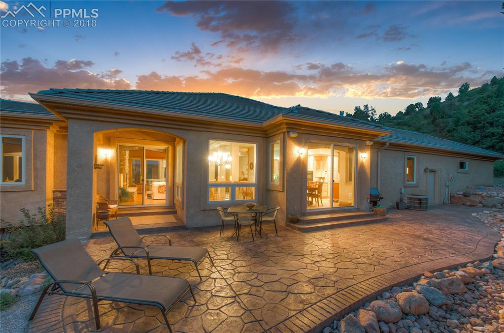 Large back patio with stamped concrete is an oasis!