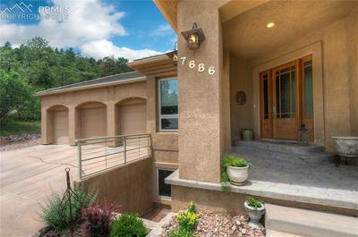 3-car oversized garage and inviting entrance~