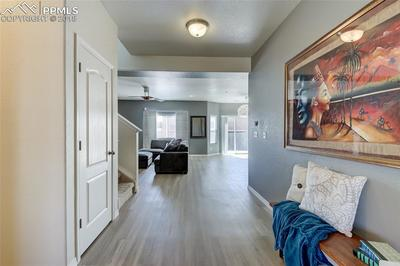 Entry has a formal living room to the left and leads to the family room, kitchen