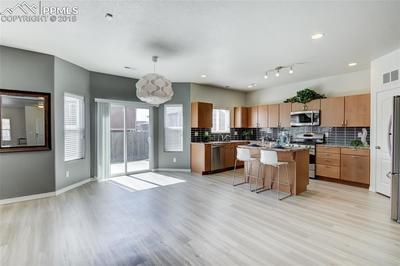 Kitchen/Dining area walks out to grassy backyard