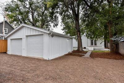 Large detached two car garage with enough parking for 3 more cars and RV parking