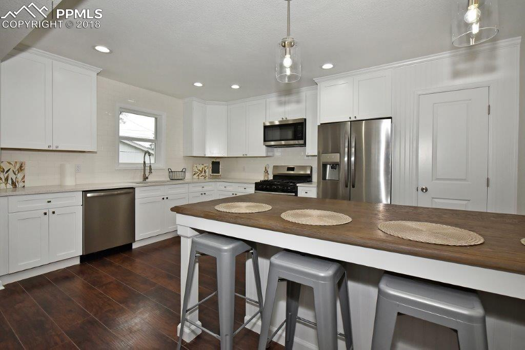 All brand new stainless steel appliances, new soft-close cabinets and subway til