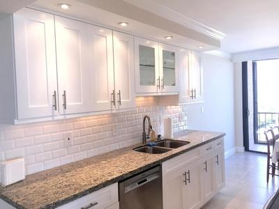 WOOD CABINETS + GRANITE COUNTERS