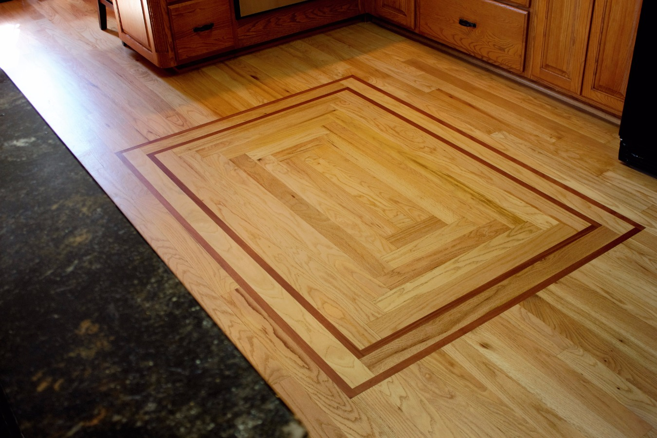 Kitchen in-lay in the Flooring
