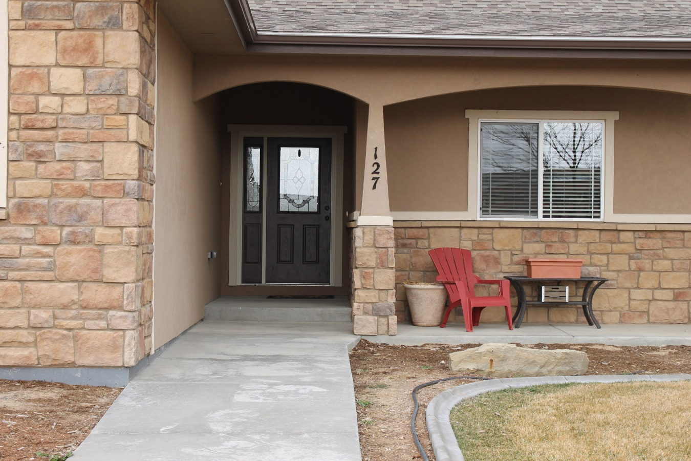 Entry with inviting porch