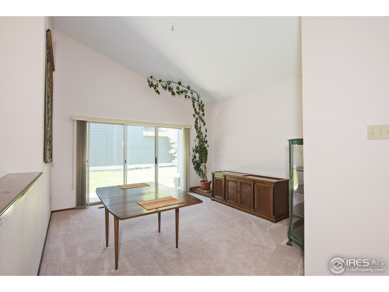 Spacious Formal Dining room opens to patio