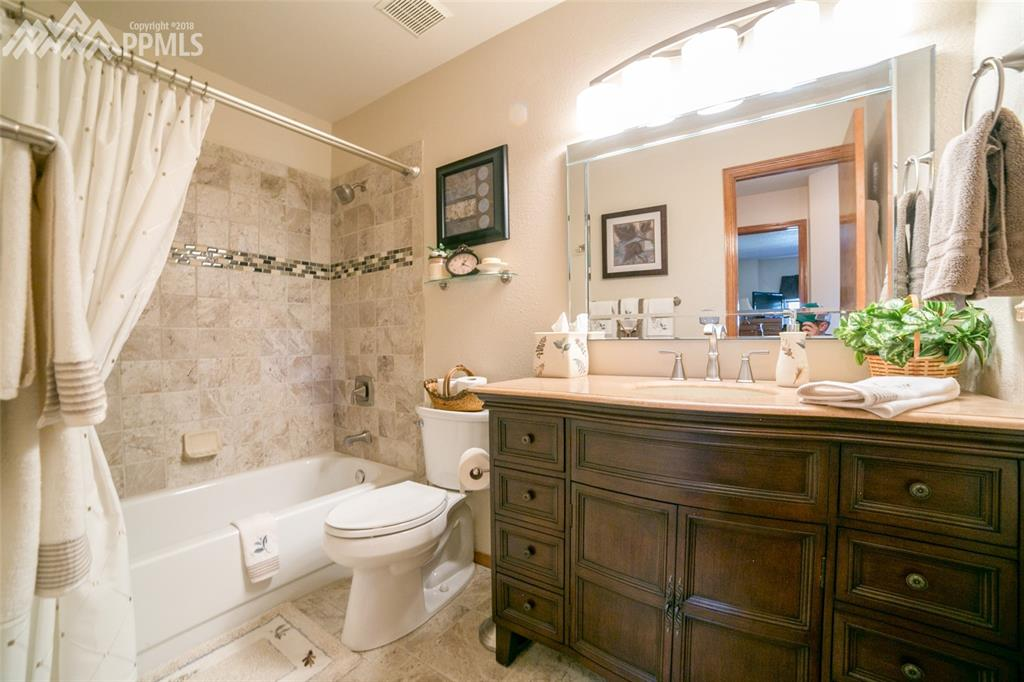Updated full bathroom on upper level for guest
