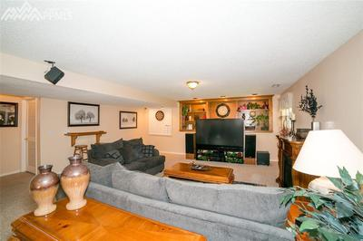 Huge basement rec room or 2nd family room, with built in shelving