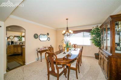 Crown molding and upgraded carpet provide an elegant feel in the formal dining r