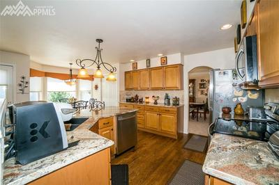 Kitchen boasts of granite counter tops, hardwood floors, and a bright breakfast
