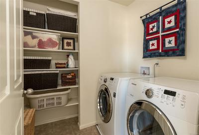 Built-in shelves in conveniently located laundry room located on upper level. Wa