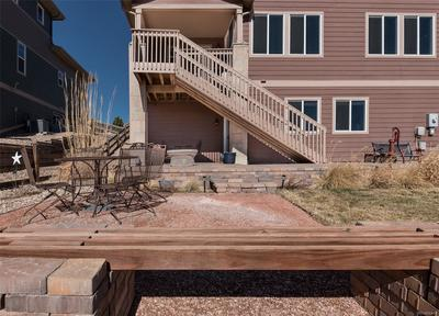 Large backyard with brick patio. Perfect for grilling outside and enjoying the v