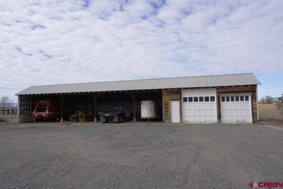 4-bay equipment shed with 2-car enclosed garage