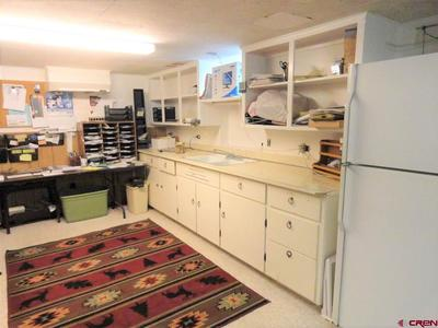 kitchen in the basement only needs a range/oven and the cabinet fronts re instal