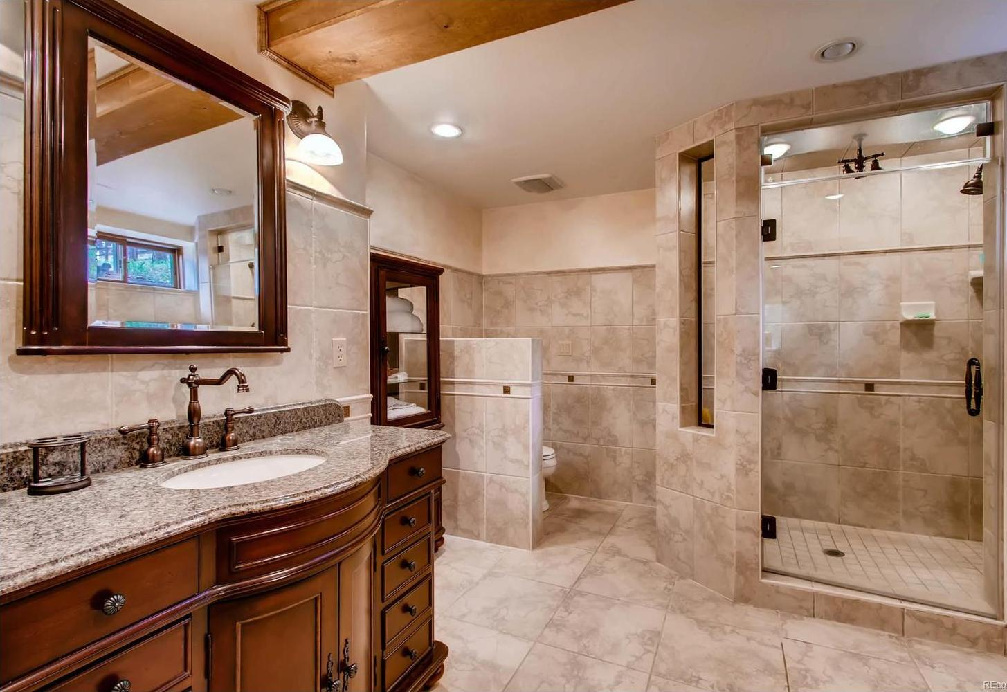 This lovely bath is adjacent to the lower level family room (master suite 2 opti