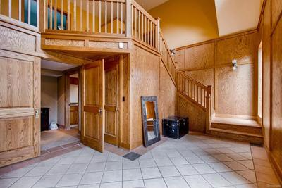 Grand entry showing 1 of the 2 staircases.