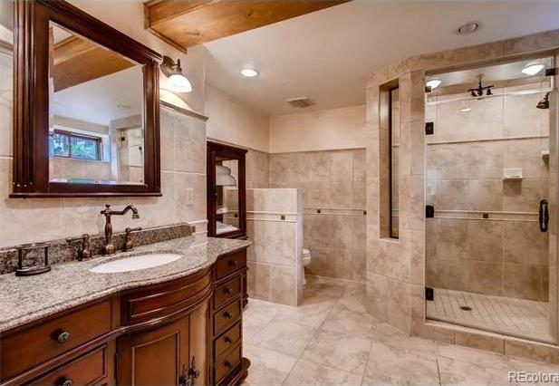 Remodeled bath adjacent to main level rec room