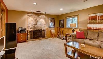 Main level rec room  with fireplace & adjacent remodeled bath.