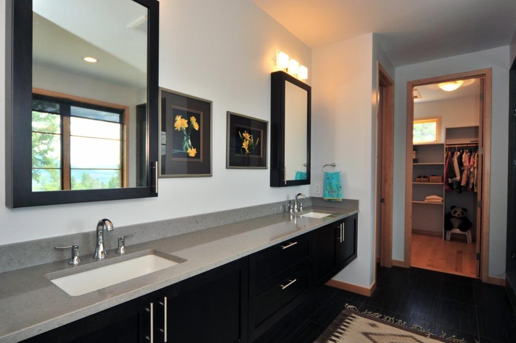 Large open vanities lead to huge master closet
