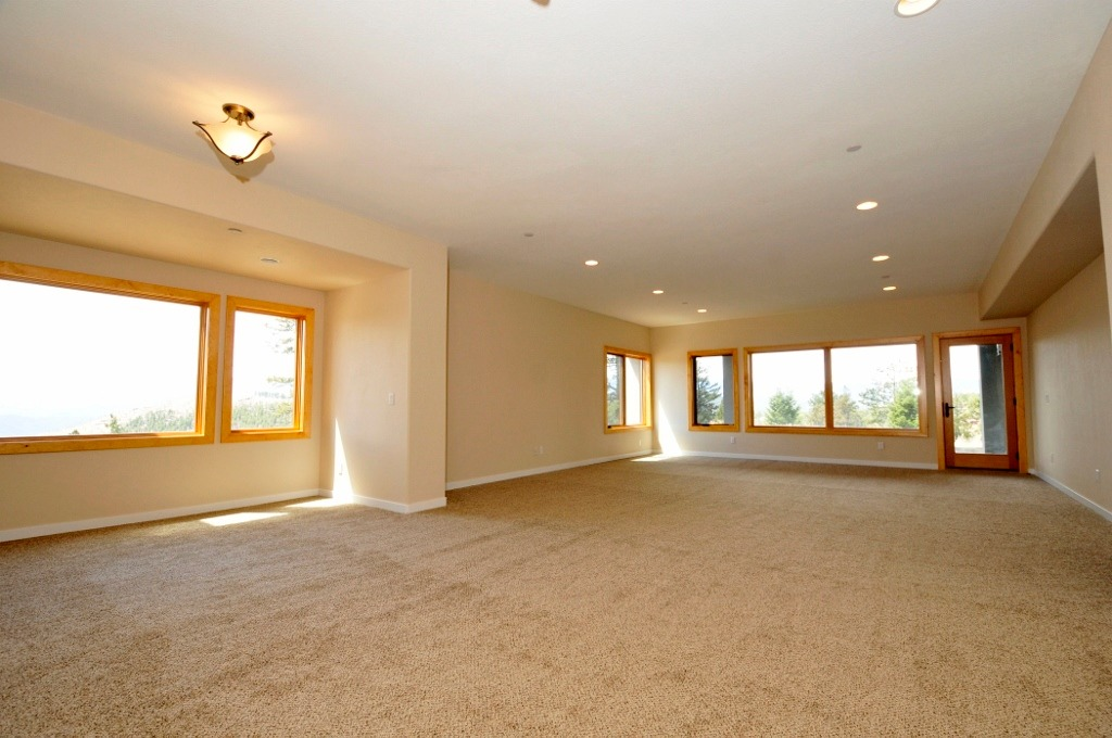 Huge, bright & sunny walk out with 9' ceilings!